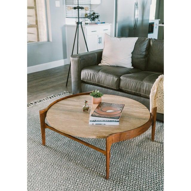 Mid-century modern coffee table designed by Bertha Schaefer in 1950. Walnut base with a very heavy Italian travertine...