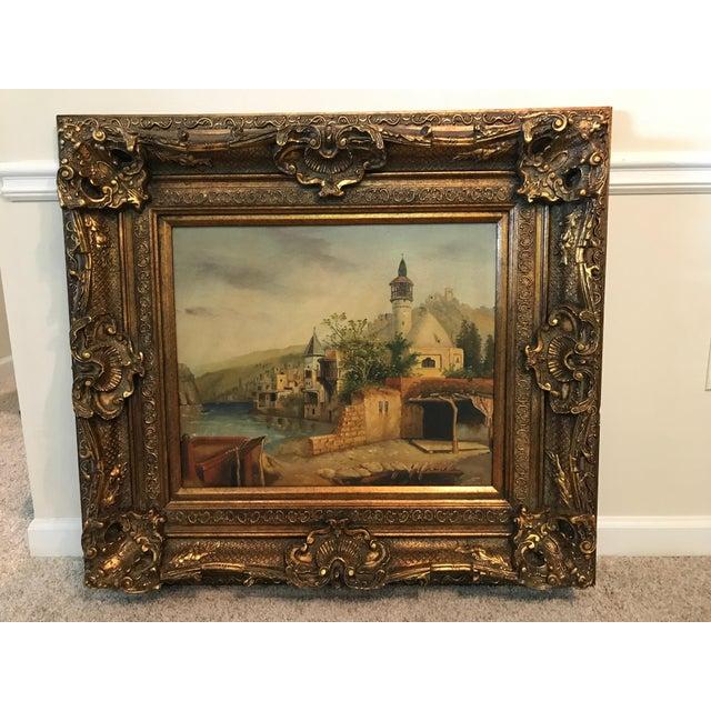 Unsigned painting of orient village scene set in huge gold gilt frame. Bought at a German Antique Market.