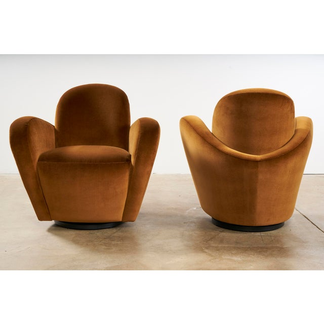 Uncommon Vladimir Kagan Swivel chairs with matching ottomans. Full 360 degree swivel on these shapely chairs, looking...