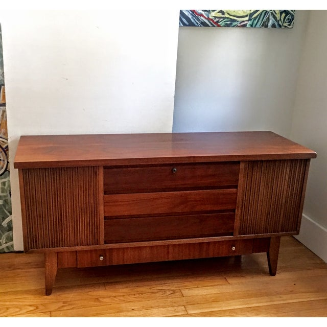 This walnut beauty looks like a credenza, but opens up to reveal a cedar lined interior with a smaller tray. Underneath...