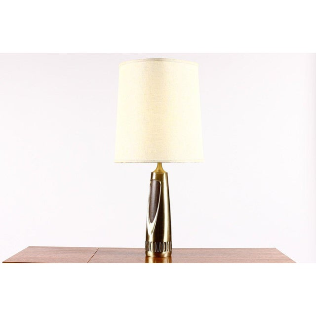 Nice large vintage table lamp by Laurel. Cast brass body with walnut detailing. Sculptural form. Great vintage condition...
