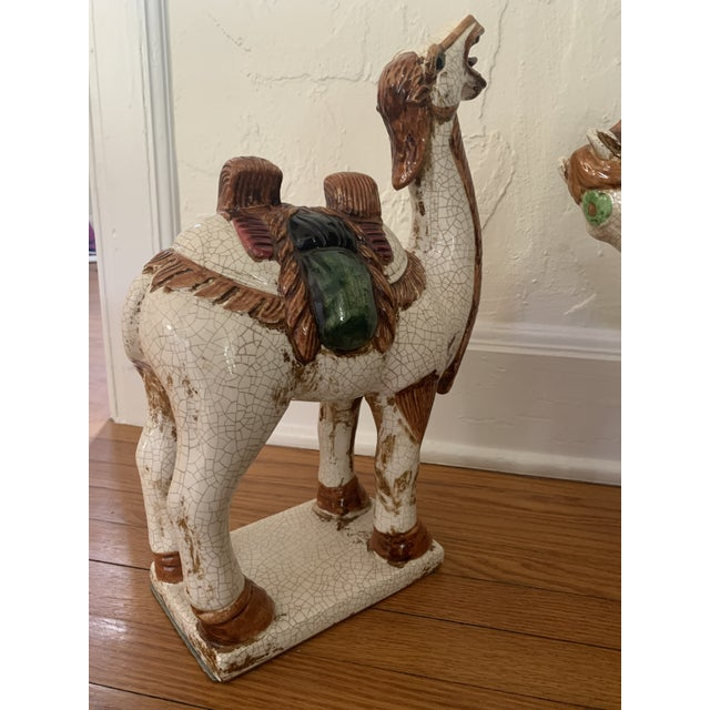 A pair of Sancai-style ceramic figures—a horse and a camel. Large with lots of presence. Blend into many decor styles....