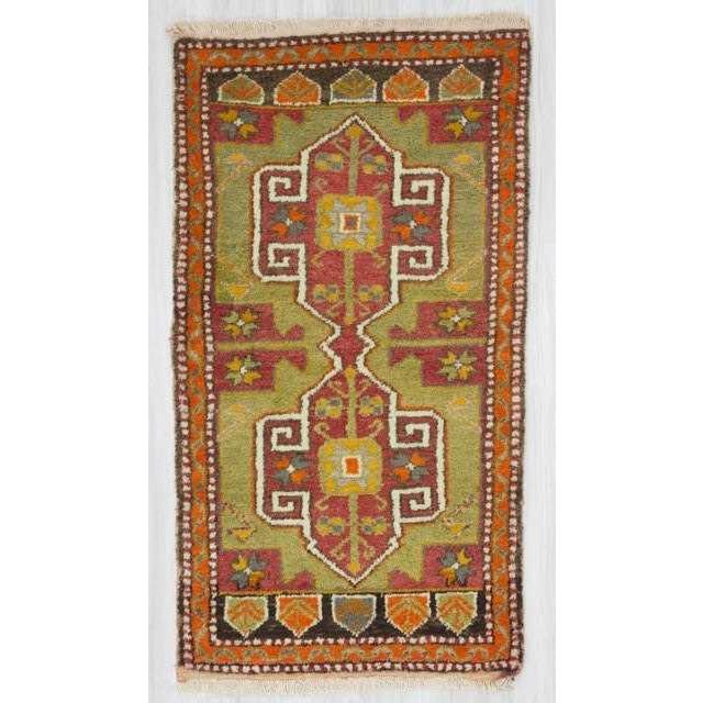 Vintage mini rug from Oushak region of Turkey. In very good condition.
