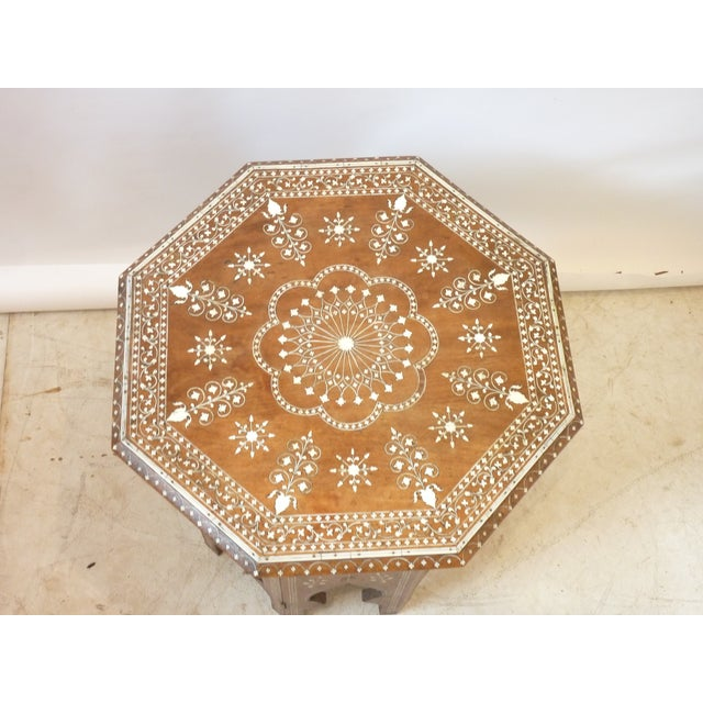 20th century Moroccan octagonal hardwood table with bone inlay, sturdy, use as a drink table, end table, or between two...