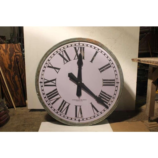 Original American 1900's over sized tower light up clock with milk etched glass face and copper frame.