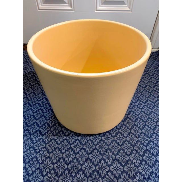 Mid-century ceramic planter attributed to Gainey Pottery but unmarked. Color is a unique peach/butterscotch. In excellent...