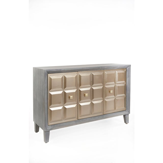 We translated the intricate design of modern spike design to create the textural pattern of our Merlin Buffet Table....