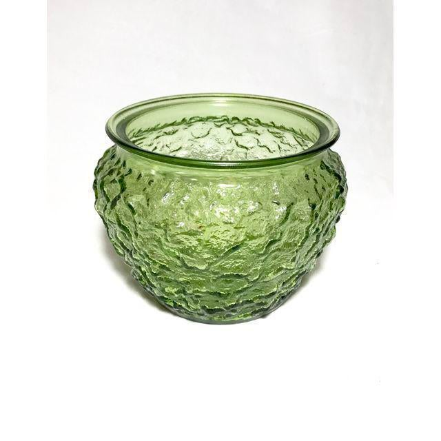 This vintage green vase is in pristine shape and will make a beautiful addition to your home.