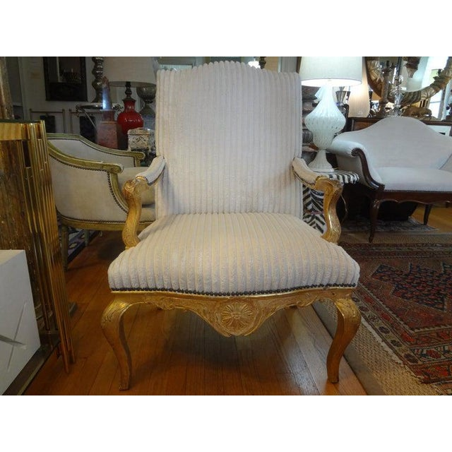 Stunning signed period 18th century French Regence giltwood fauteuil or armchair. This beautiful giltwood chair has...