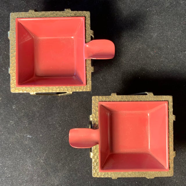 A Pair of Geometric Brass Hammered Minimal Ashtrays from the 1950s. If you're looking for a unique Mauve color pop for an...