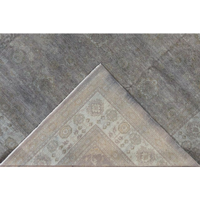 A contemporary grey overdyed rug from Pakistan with a subtle underlying all-over design. This hand knotted wool rug...