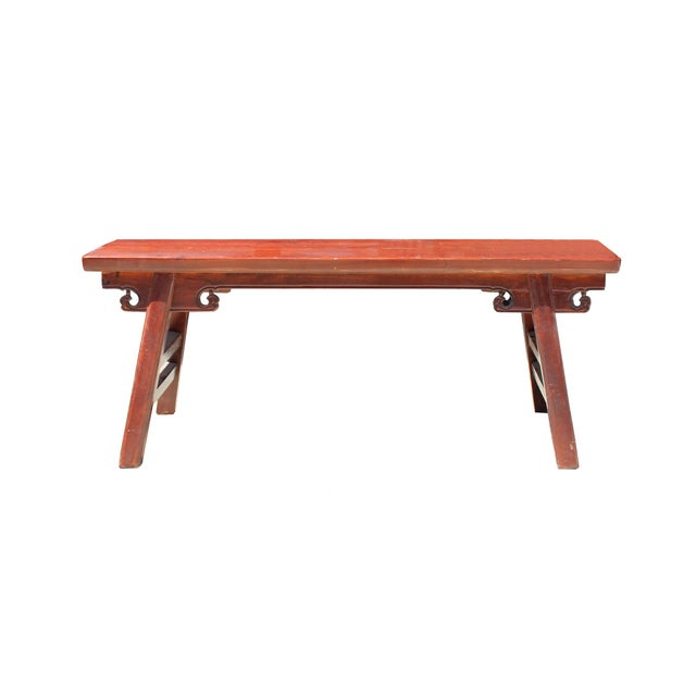 This is a traditional Chinese wood bench with narrow seating plank and H shape legs. The surface is finished with...