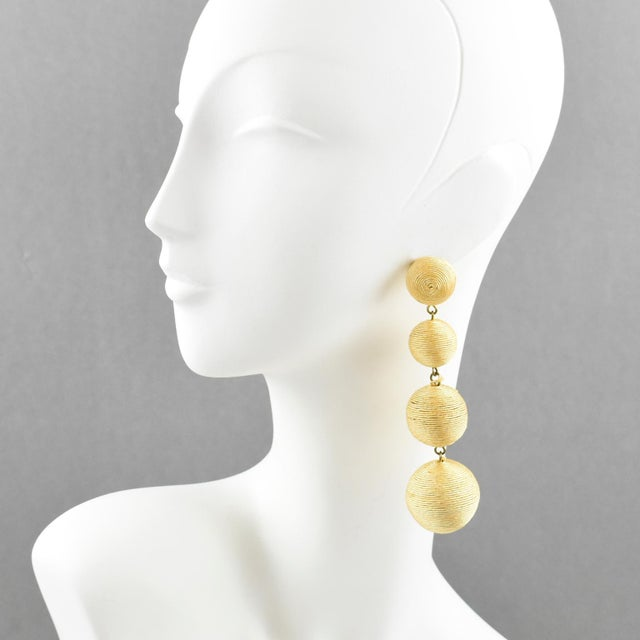 Disco perfection, these pierced earrings are the total look 1980s. Oversized long chandelier dangle shape with graduated...