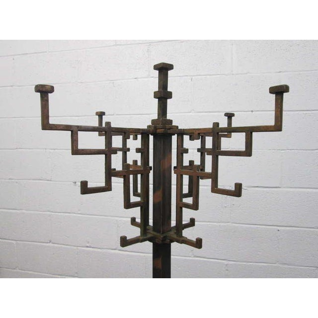 """Copper-plated steel coat tree/rack with 12 hooks. Measures: 71.5""""H. Base is 21"""" x 21.""""."""