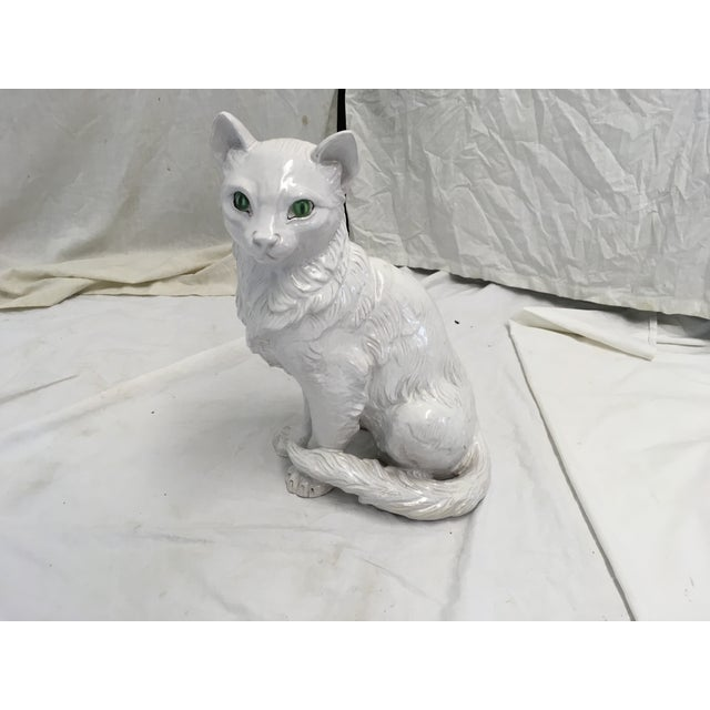 Hard to find, Italian terracotta cat figurine. All white, w/ green eyes, and lifelike in size.