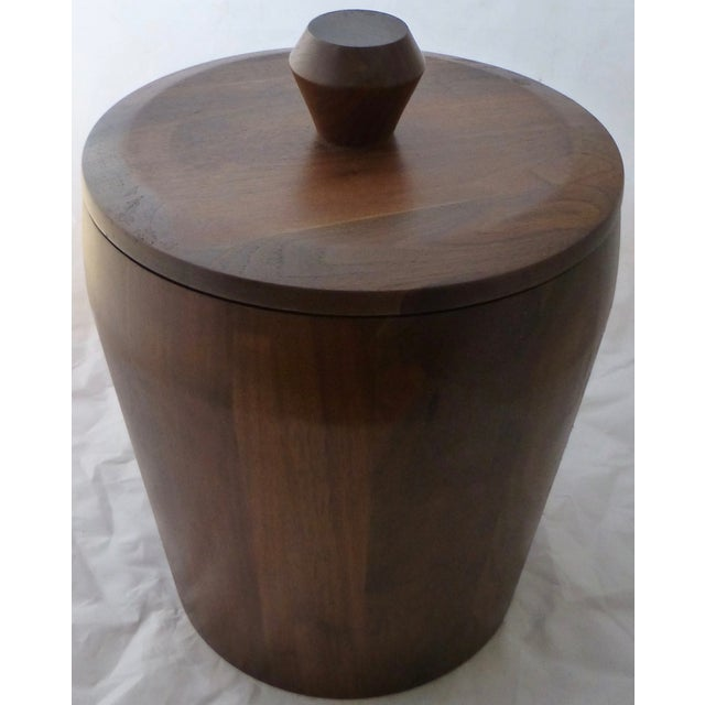 Killer walnut ice bucket, dating circa 1960. This one is crafted of walnut and has a removable plastic liner for easy...