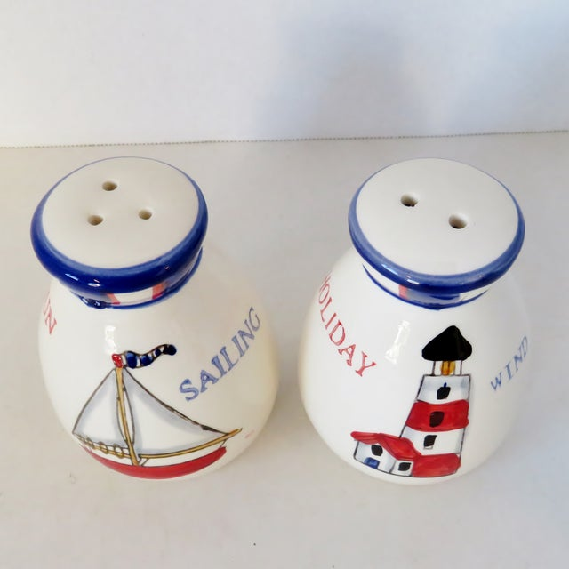 A pair of porcelain hand-painted salt & pepper shakers with nautical motif. Purchased in Germany. No maker's marks. Light...