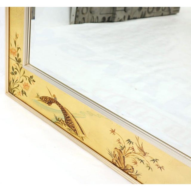 Reverse painted gold leaf rectangular frame decorative mirror by La Barge. Artist-signed and dated 1979.