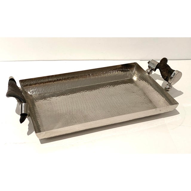 "Stylish hammered steel serving tray with horn handles. Generous size with depth 1 3/4"". of the tray part. Overall size..."
