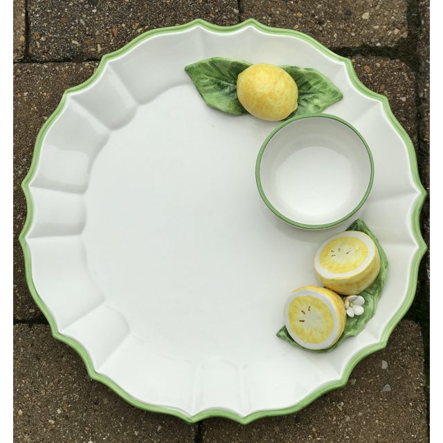 Lovely white one-piece majolica serving platter with attached sculptural bright yellow lemons, spring green leaves, and a...