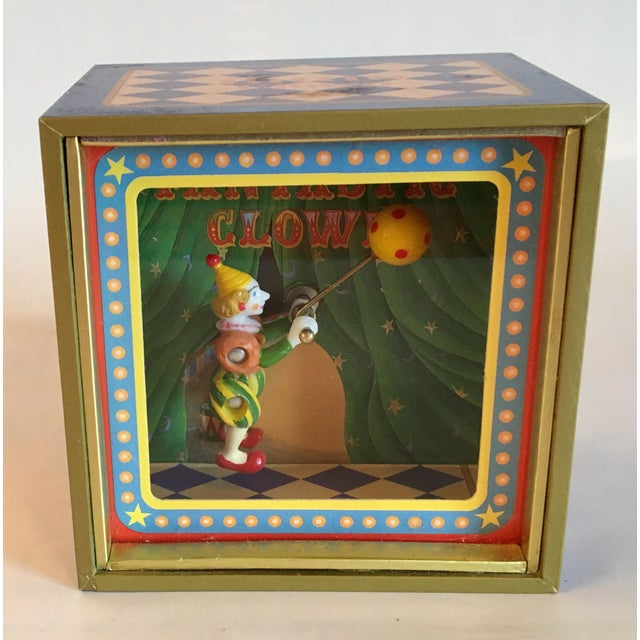 This vintage animated shadow box is more 3D than the newer versions with an articulated clown and ball that rotate around...
