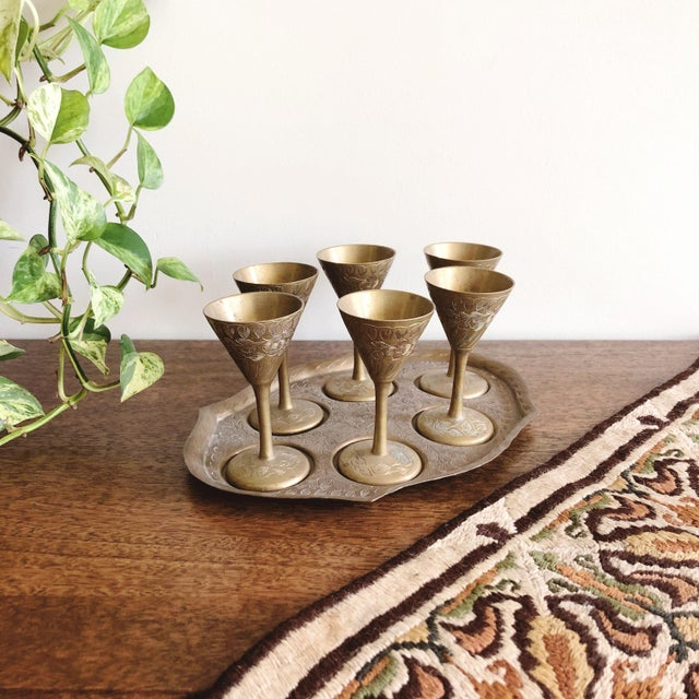 Vintage brass cordial set with 6 mini goblets and matching tray. Each brass goblet holds 1 oz. Made in India.
