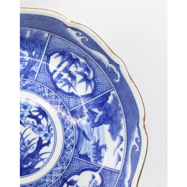 Older vintage extremely well rendered blue & white Japanese Imari School porcelain dish. Signed by the artist on...
