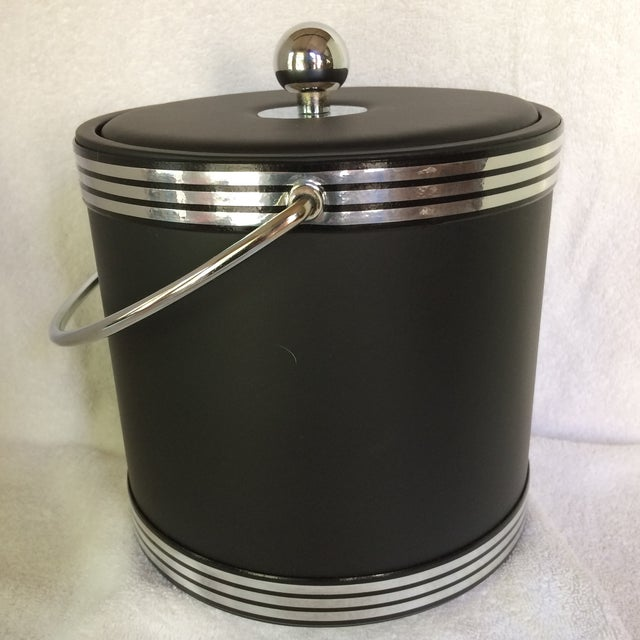 Never used Kraftware black Naugahyde and chrome ice bucket. This ice bucket was found with its original box in original...