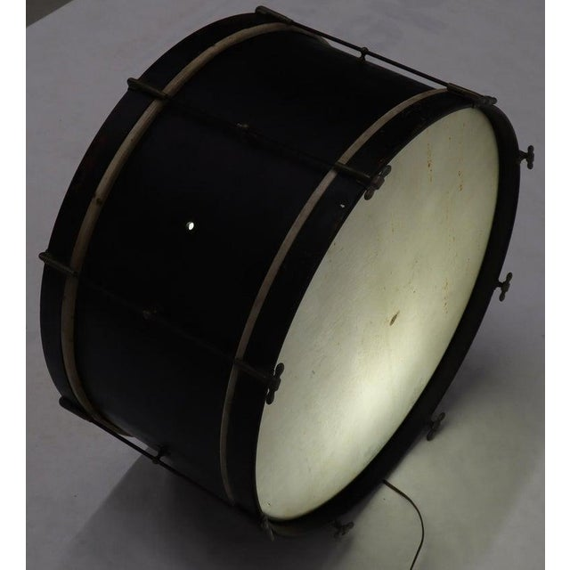 Unusual item large vintage drum painted and converted into a floor lamp light fixture.