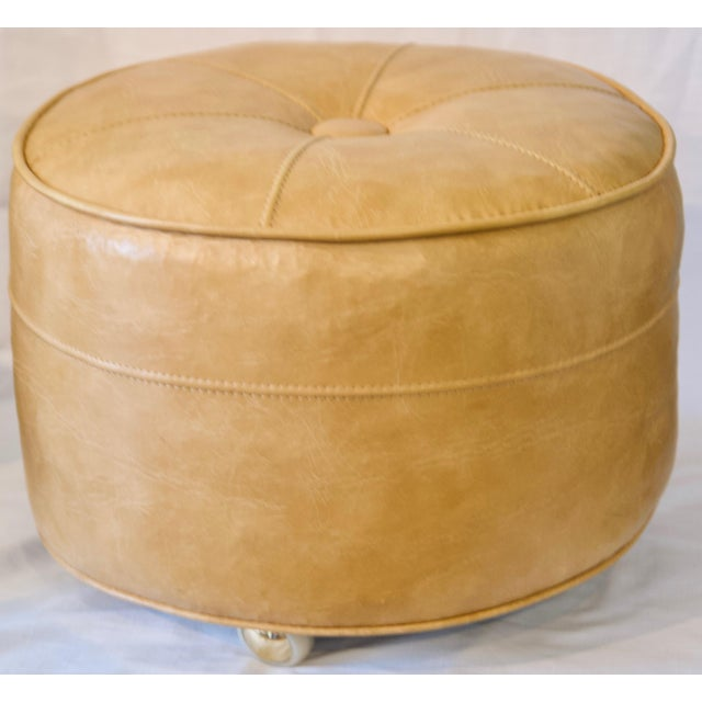 Make your favorite chair even cozier by adding this vintage leather rolling ottoman to rest your feet upon! This awesome...