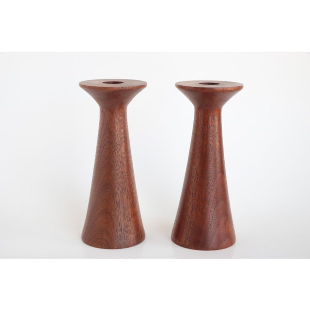 Matching pair of Danish modern style turned wood candle holders. Berea College style, in the manner of Rude Osolnik. They...