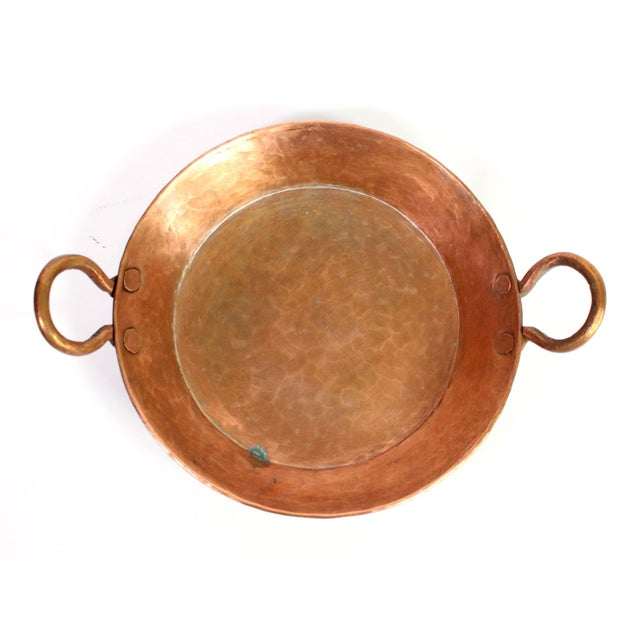This stunning antique French pan hand made in the late 1800's, is made of solid, thick wide-hammered copper has both a...