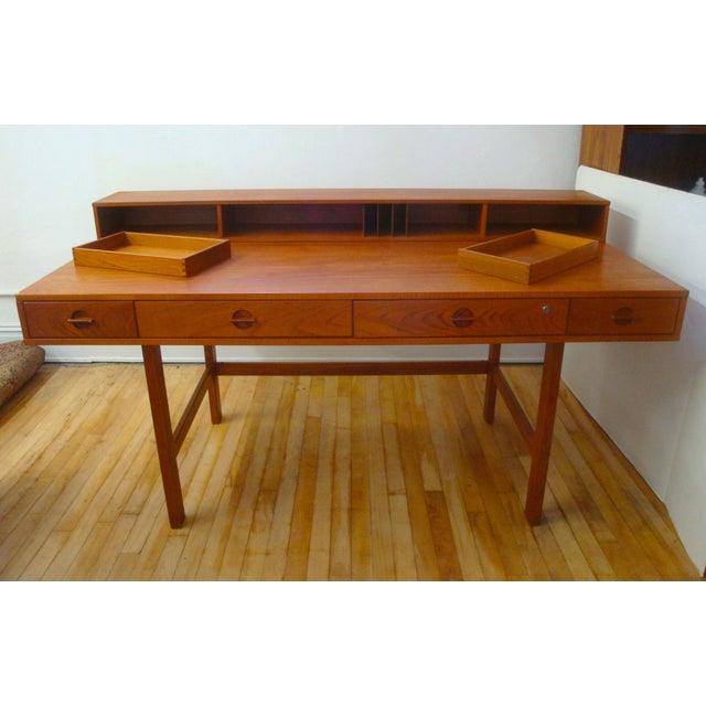 Danish Modern midcentury teak convertible desk or dining / work table. Marked: Dansk Lovig. Designed by Jens Quistgaard;...