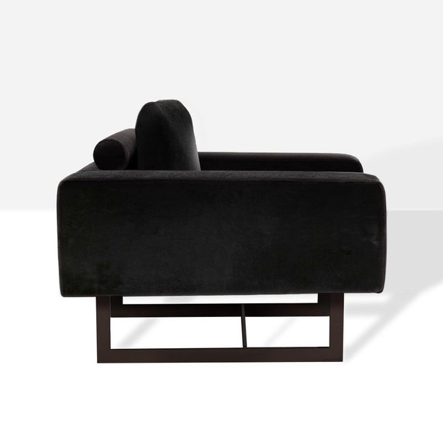 This bold occasional chair is upholstered in a slick, pitch black, Brazilian hair-on-hide and sits on a bronzed base. The...
