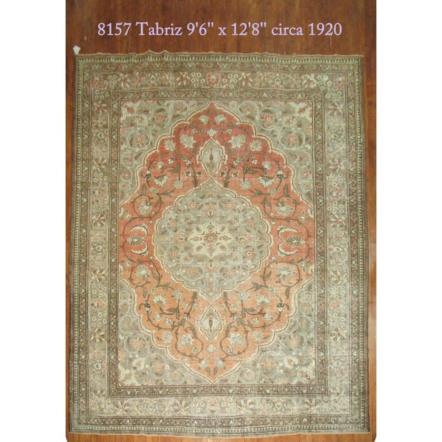 An early 20th century one of a kind persian decorative tabriz rug in browns and orange with great patina and texture.