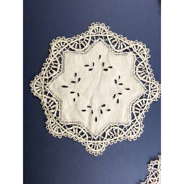 """Circa 1930's ecru linen table mat set of 17. Linen centers with cutwork, machine lace scalloped borders. 6 large size 10""""..."""