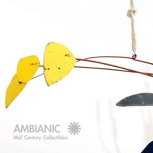 Vintage mobile made of metal. Painted in red, blue and yellow colors. Unsigned. In the style of Alexander Calder. Rust...