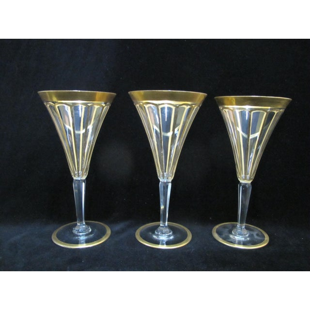 "Beautiful vintage glassware set of 6 champagne glasses each in clear glass with gold gilt. Each measures 7 1/2"" tall x 4""..."