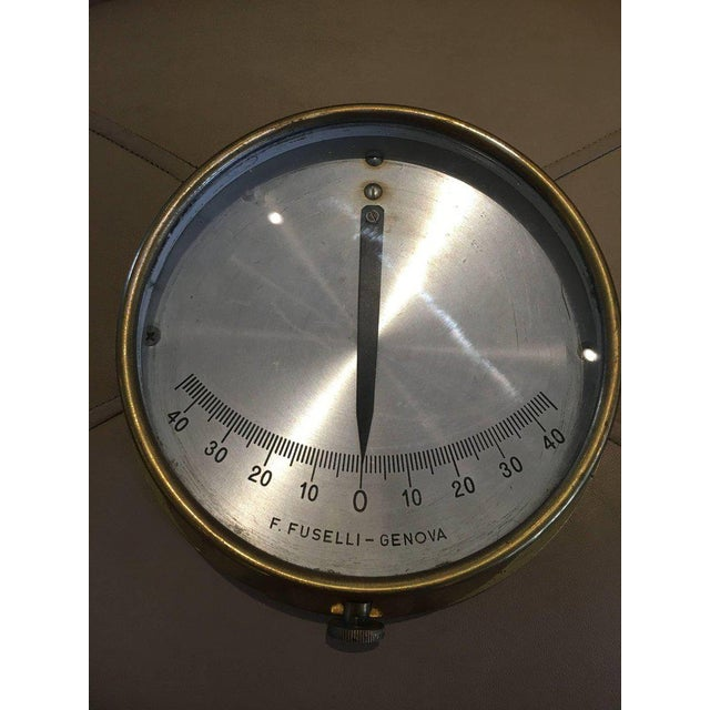 Midcentury Italian ship's brass clinometer. These tilt gauges were used on vessels to measure the angular slant of the...
