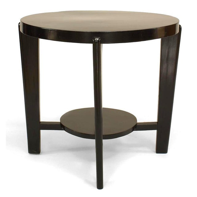 Italian 1940s ebonized round coffee table with round shelf supported by a stretcher and four tapered legs (AS IS).