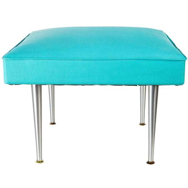 Very large square padded vinyl stool with spun aluminum legs from the mid century era. This vintage modern square bench or...