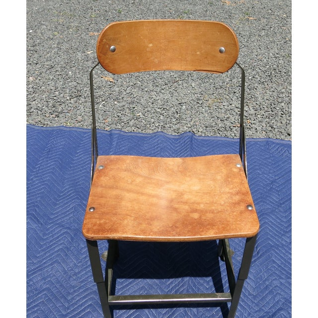 """Industrial Bent plywood adjustable chair. Some veneer loss and separation. It is 33.5"""" high, 16"""" wide and 15' deep. The..."""