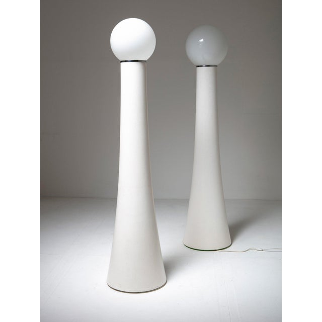 """Pair of floor lamps model """"KD59"""" by Annig Sarian for Kartell. Important white fiberglass base support the milky glass shade."""