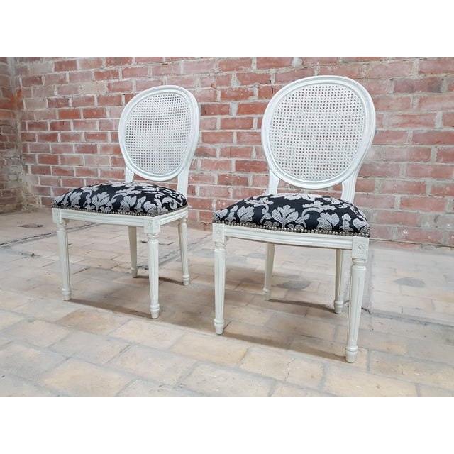 French Pair of Vintage French Louis XVI Newly Upholstered Cane Back White Accent Chairs For Sale - Image 3 of 13