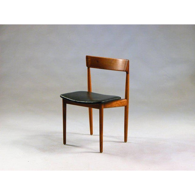 Set of four model 39 dining chairs in teak and black leather designed by Henry Rosengren Hansen for Brande Møbelindustri,...