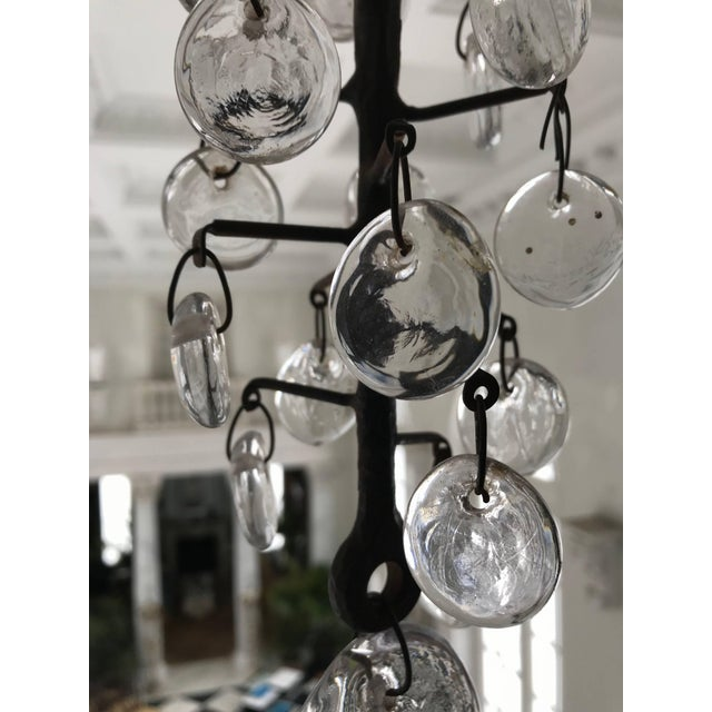 This Original Eric Hoglund (for Kosta Boda) 11-arm Chandelier was made of hand-wrought iron and circular, clear glass...
