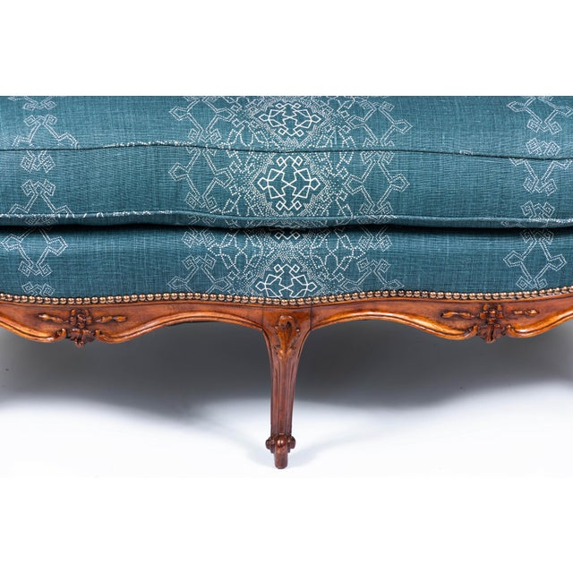 """1940s settee with three Queen Anne style front legs and carvings on a wood base. Newly upholstered in """"Aswan Monsoon' 100%..."""
