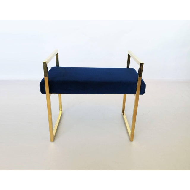 Pair of polished brass benches designed by Charles Hollis Jones in the 1970s. The frames of the benches are brass, they...