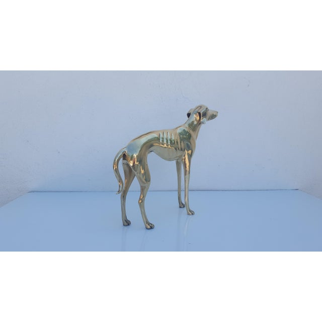 Vintage / Hollywood Regency Brass Sculpture depicts a Whippet or small Greyhound. It brings the Hollywood Regency Glamour...