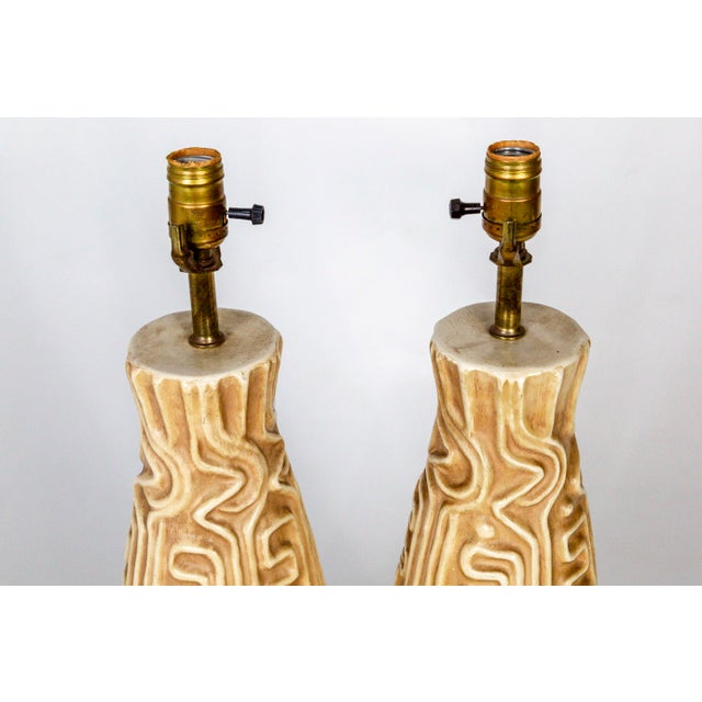 Tall Mid-Century High Relief Carved Tan Pottery Lamps - a Pair For Sale In San Francisco - Image 6 of 11